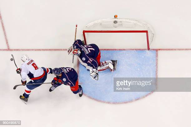 Seth Jones of the Columbus Blue Jackets plays defense as Alex Ovechkin of the Washington Capitals attempts to shoo the puck on Sergei Bobrovsky of...
