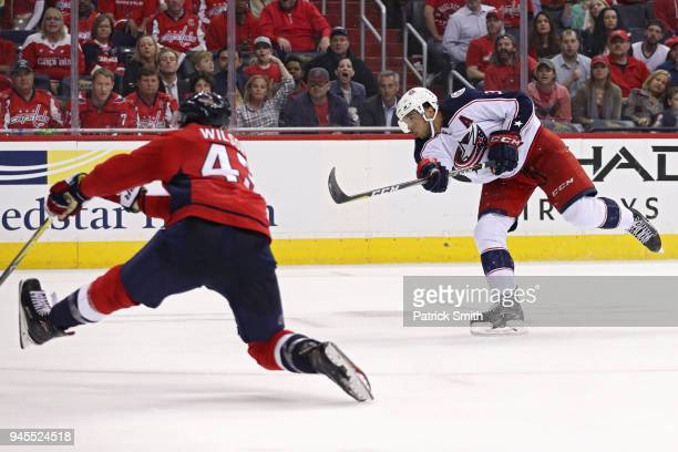 Seth Jones of the Columbus Blue Jackets scores a goal in front of Tom Wilson of the Washington Capitals in the third period in Game One of the...