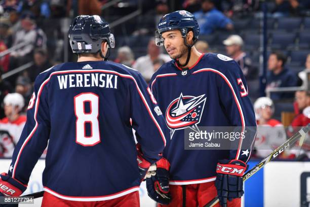 Seth Jones of the Columbus Blue Jackets talks with Zach Werenski of the Columbus Blue Jackets prior to a faceoff during the second period of a game...