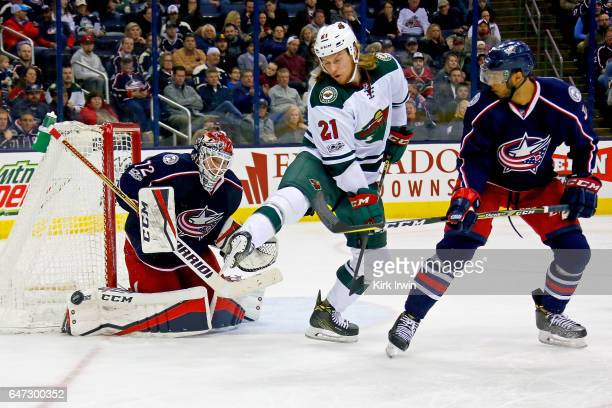Seth Jones of the Columbus Blue Jackets watches as Sergei Bobrovsky of the Columbus Blue Jackets makes a save while being screened by Ryan White of...