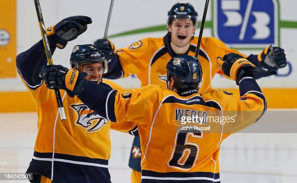 Seth Jones of the Nashville Predators celebrates his first NHL goal with Shea Weber against the New York Islanders at Bridgestone Arena on October 12...
