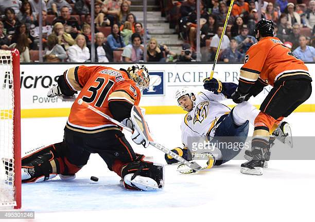 Seth Jones of the Nashville Predators is knocked to the ice by Kevin Bieksa of the Anaheim Ducks as Frederik Andersen makes a save during the second...
