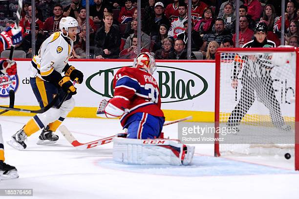 Seth Jones of the Nashville Predators shoots the puck past Carey Price of the Montreal Canadiens to score the gamewinning goal during the NHL game at...
