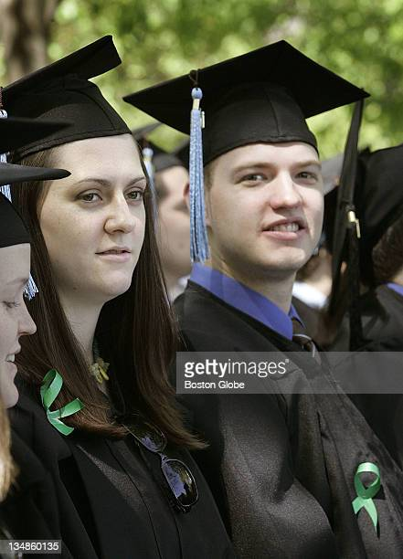 Seth Lancaster right of West Virginia and Joanna Troy left of Wellesley wore green ribbons at Tufts University commencement exercises to show that...