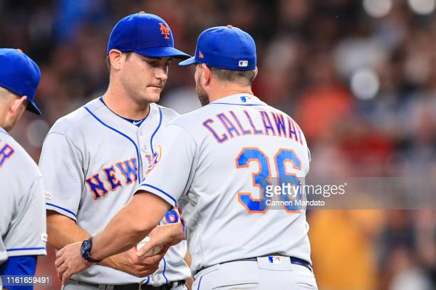 Seth Lugo hands the game ball to Mickey Callaway of the New York Mets in the seventh inning during the game against the Atlanta Braves at SunTrust...