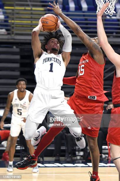 Seth Lundy of the Penn State Nittany Lions drives to the basket past Myles Johnson of the Rutgers Scarlet Knights in the first half during a college...