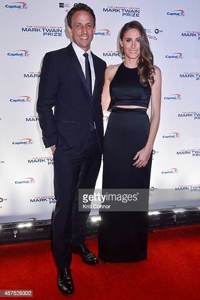 Seth Meyers and Alexi Ashe walk the red carpet during the 2014 Kennedy Center's Mark Twain Prize For Americacn Humor at The John F Kennedy Center for...