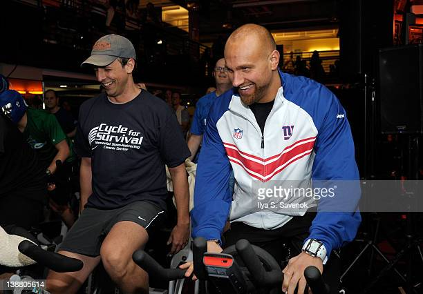 Seth Meyers and Mark Herzlich cycle at the 2012 Cycle For Survival - Day 2 at Equinox Graybar on February 12, 2012 in New York City.