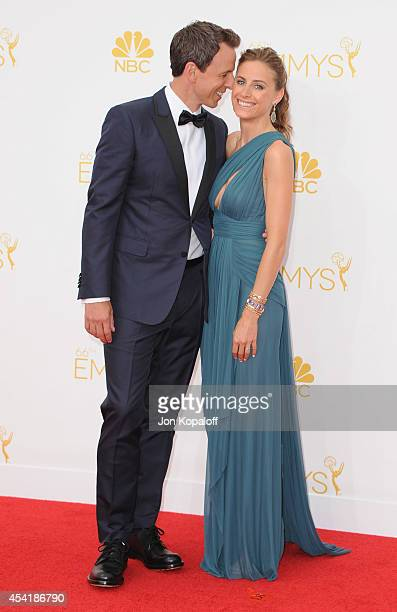 Seth Meyers and wife Alexi Ashe arrive at the 66th Annual Primetime Emmy Awards at Nokia Theatre LA Live on August 25 2014 in Los Angeles California