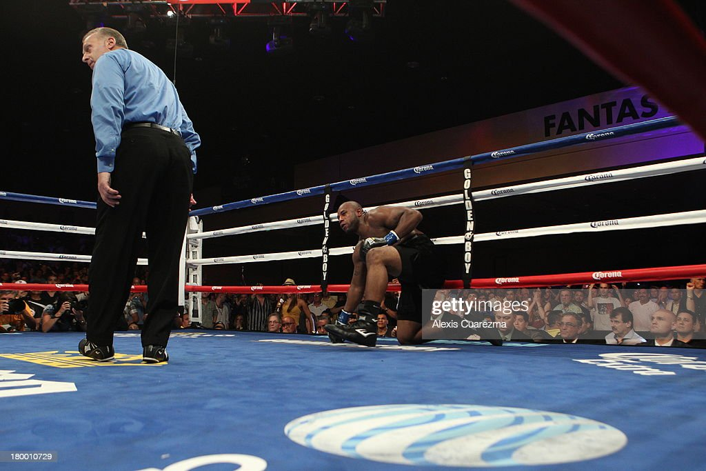Seth Mitchell (R) gets up from the canvas after being knocked down by Chris Arreola as referee Jack Reiss gets ready to give him an ten count during the WBC International Heavyweight Title at the Fantasy Springs Resort Casino - Special Events Center on September 7, 2013 in Indio, California.