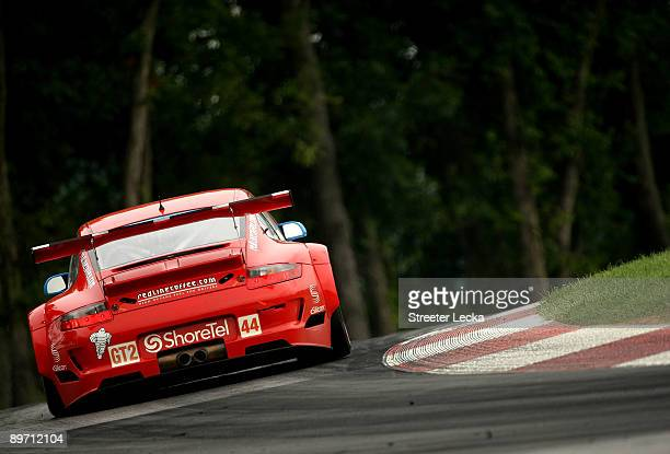 Seth Neiman driver of the Flying Lizard Motorsports ShoreTel/eSilicon/RedlineCoffeecom Porshe 911 GT3 RSR during the American Le Mans Series Acura...