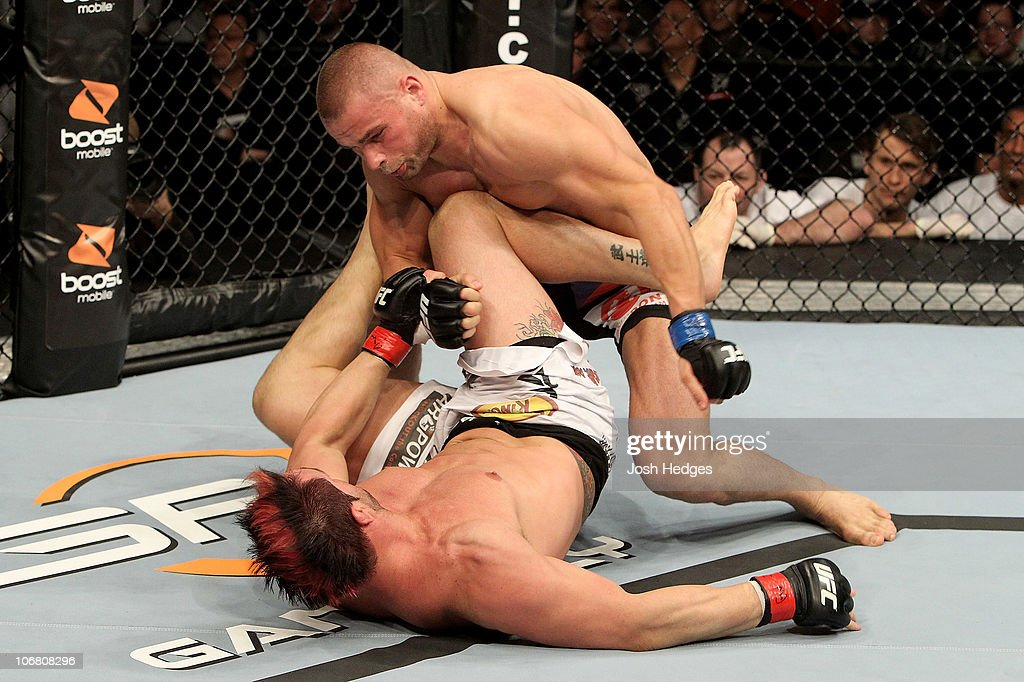 Seth Petruzelli of the USA fights with Karlos Vemola (R) of the Czech Republic during their UFC Light Heavyweight bout at the Konig Pilsner Arena on November 13, 2010 in Oberhausen, Germany.