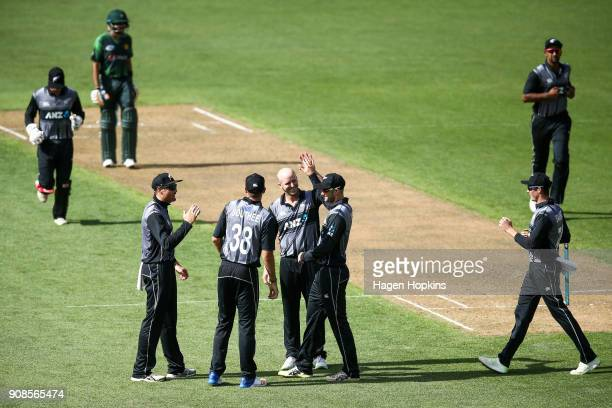 Seth Rance of New Zealand celebrates with teammate Tom Bruce after taking the wicket of Hasan Ali of Pakistan during game one of the Twenty20 series...