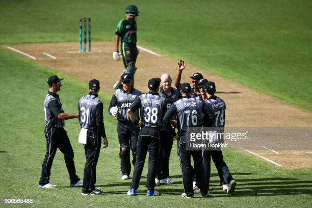 Seth Rance of New Zealand celebrates with teammates after taking the wicket of Hasan Ali of Pakistan during game one of the Twenty20 series between...