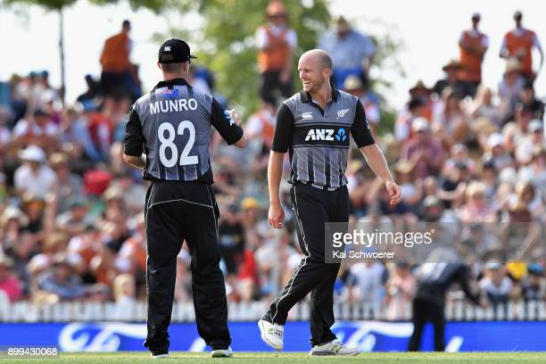 Seth Rance of New Zealand is congratulated by Colin Munro of New Zealand after taking the final wicket to give New Zealand victory over the West...