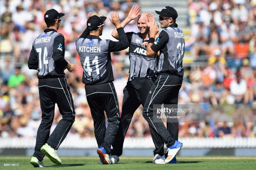 Seth Rance of New Zealand is congratulated by team mates after dismissing Chadwick Walton of the West Indies during game one of the Twenty20 series between New Zealand and the West Indies at Saxton Field on December 29, 2017 in Nelson, New Zealand.