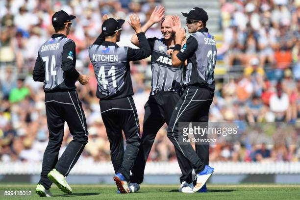 Seth Rance of New Zealand is congratulated by team mates after dismissing Chadwick Walton of the West Indies during game one of the Twenty20 series...