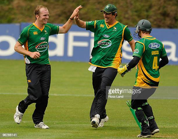 Seth Rance of the Central Staggs is congratulated by Matthew Sinclair and Bevan Griggs after taking a wicket during their win over the Auckland Aces...