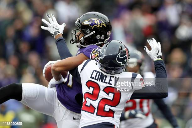 Seth Roberts of the Baltimore Ravens catches a 15 yard touchdown pass from Lamar Jackson against Gareon Conley of the Houston Texans during the...