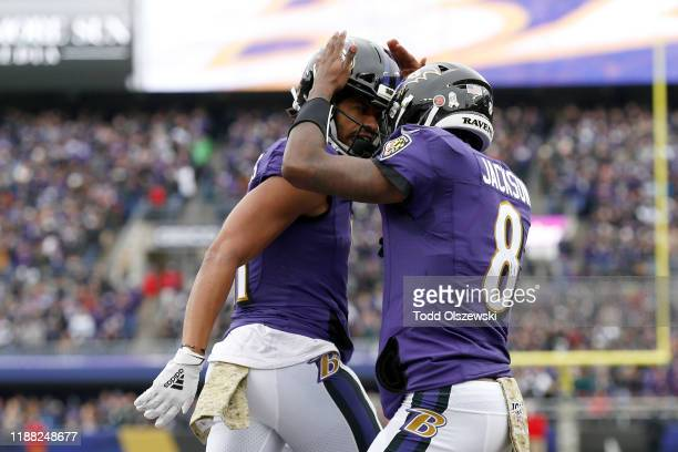 Seth Roberts of the Baltimore Ravens celebrates with Lamar Jackson after scoring a 15 yard touchdown pass against the Houston Texans during the...