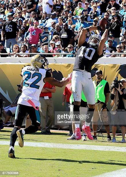 Seth Roberts of the Oakland Raiders catches a touchdown pass in front of Aaron Colvin of the Jacksonville Jaguars during the game at EverBank Field...