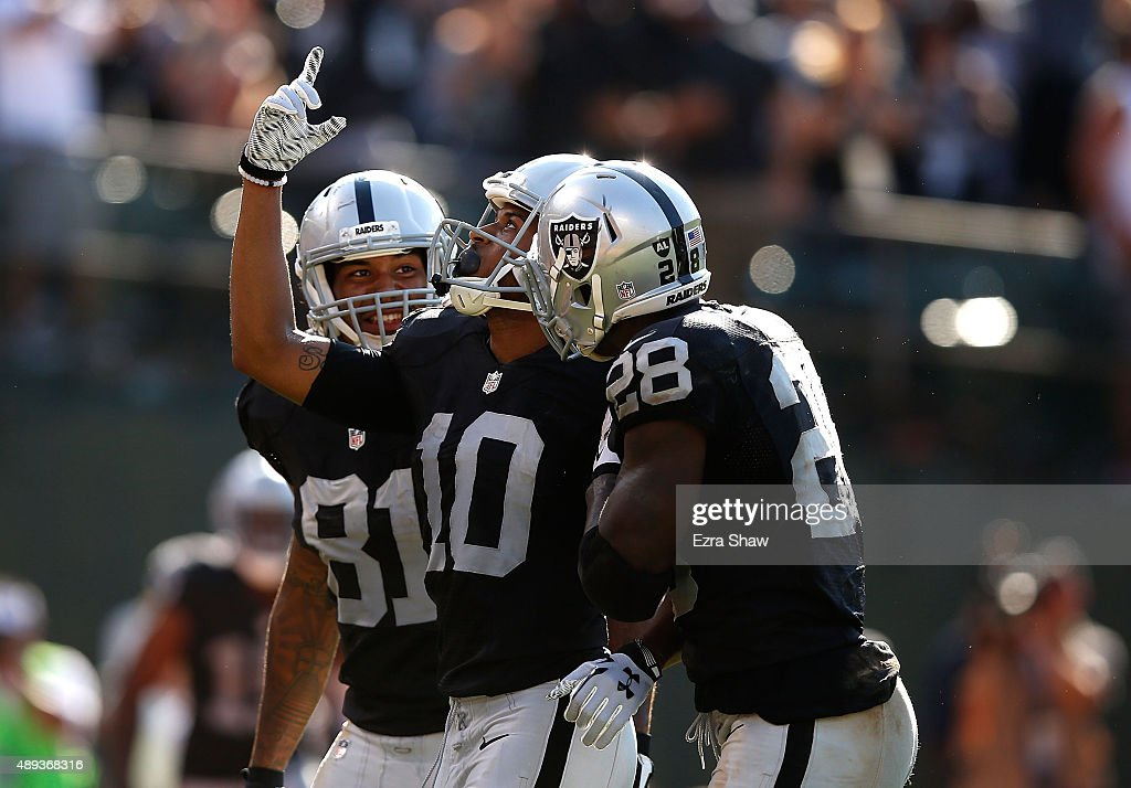 Seth Roberts #10 of the Oakland Raiders celebrates the game winning touchdown with Latavius Murray #28 of the Oakland Raiders and Mychal Rivera #81 of the Oakland Raiders in the fourth quarter against the Baltimore Ravens at Oakland-Alameda County Coliseum on September 20, 2015 in Oakland, California.