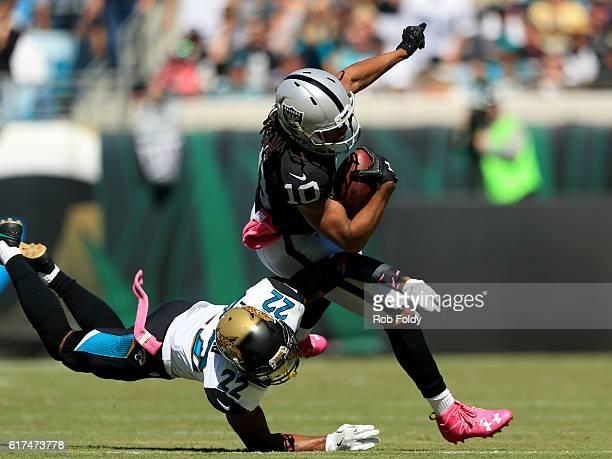 Seth Roberts of the Oakland Raiders is tackled by Aaron Colvin of the Jacksonville Jaguars during the game at EverBank Field on October 23 2016 in...