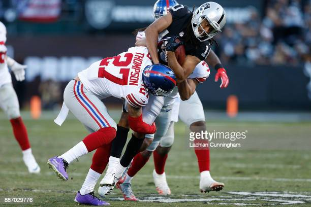 Seth Roberts of the Oakland Raiders is tackled by Darian Thompson and Ross Cockrell of the New York Giants at OaklandAlameda County Coliseum on...