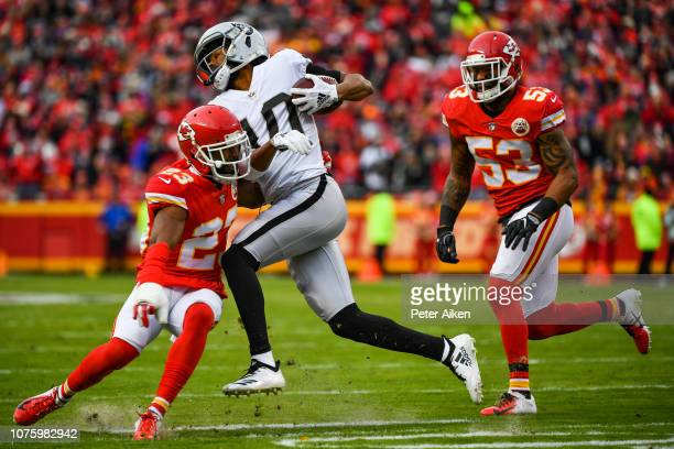 Seth Roberts of the Oakland Raiders is tackled by Kendall Fuller of the Kansas City Chiefs during the first half of the game at Arrowhead Stadium on...