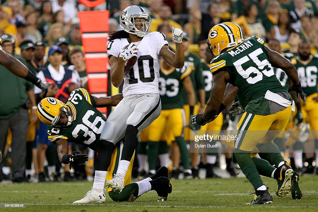 Seth Roberts #10 of the Oakland Raiders is tackled by LaDarius Gunter #36 of the Green Bay Packers in the second quarter of a preseason game at Lambeau Field on August 18, 2016 in Green Bay, Wisconsin.