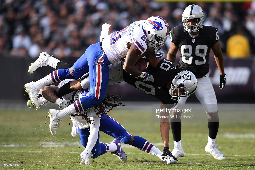 Seth Roberts #10 of the Oakland Raidersis tackled after a catch against the Buffalo Bills during their NFL game at Oakland Alameda Coliseum on December 4, 2016 in Oakland, California.