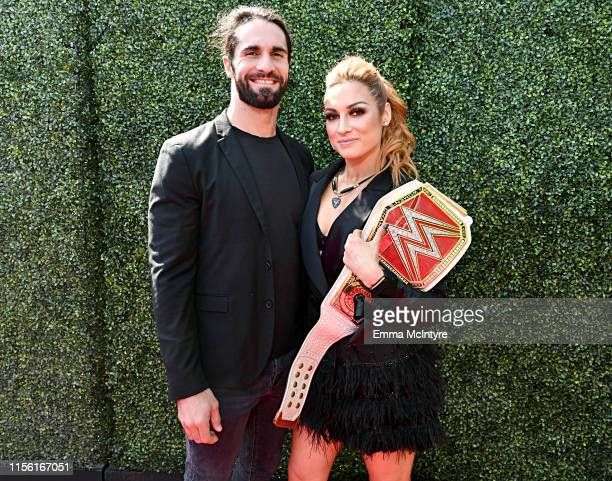 Seth Rollins and Becky Lynch attend the 2019 MTV Movie and TV Awards at Barker Hangar on June 15 2019 in Santa Monica California