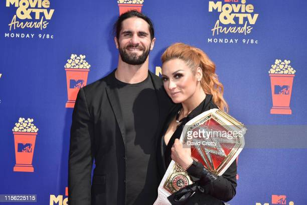 Seth Rollins and Becky Lynch attend the 2019 MTV Movie TV Awards at Barker Hangar on June 15 2019 in Santa Monica California