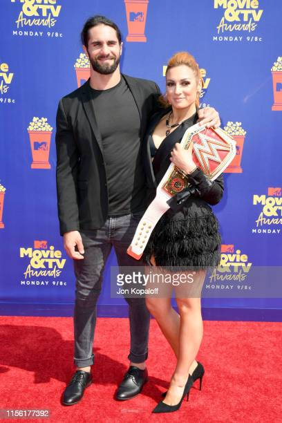 Seth Rollins and Becky Lynch attends the 2019 MTV Movie and TV Awards at Barker Hangar on June 15 2019 in Santa Monica California
