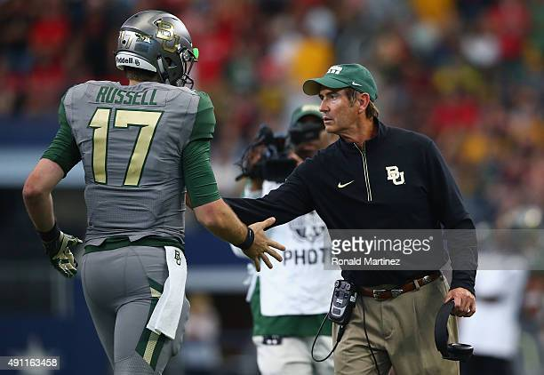 Seth Russell of the Baylor Bears celebrates his touchdown with Art Briles in the second quarter against the Texas Tech Red Raiders at AT&T Stadium on...