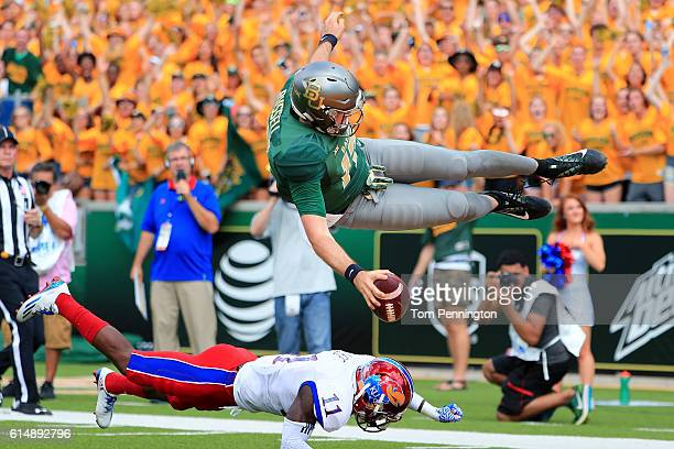 Seth Russell of the Baylor Bears scores a touchdown against Mike Lee of the Kansas Jayhawks in the first quarter on October 15 2016 in Waco Texas