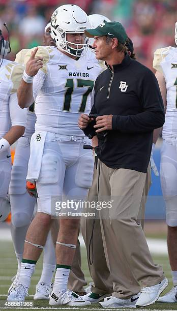 Seth Russell of the Baylor Bears talks with head coach Art Briles of the Baylor Bears in the first quarter against the Southern Methodist Mustangs...