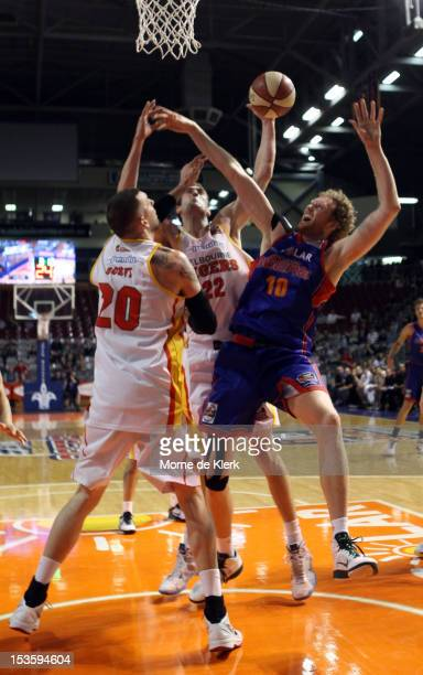 Seth Scott of the Tigers competes with Luke Schenscher of the 36ers during the round one NBL match between the Adelaide 36ers and the Melbourne...