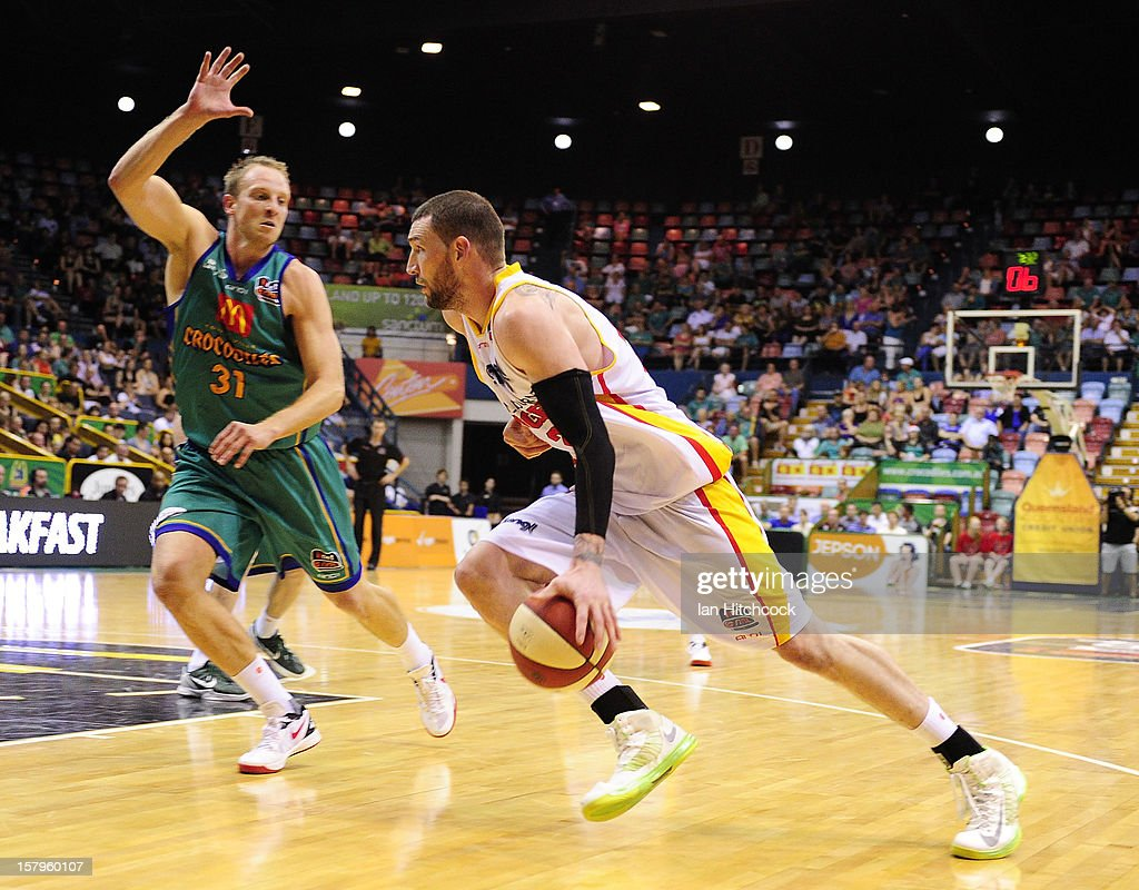 Seth Scott of the Tigers drives past Jacob Holmes of the Crocodiles during the round ten NBL match between the Townsville Crocodiles and the Melbourne Tigers at Townsville Entertainment Centre on December 8, 2012 in Townsville, Australia.