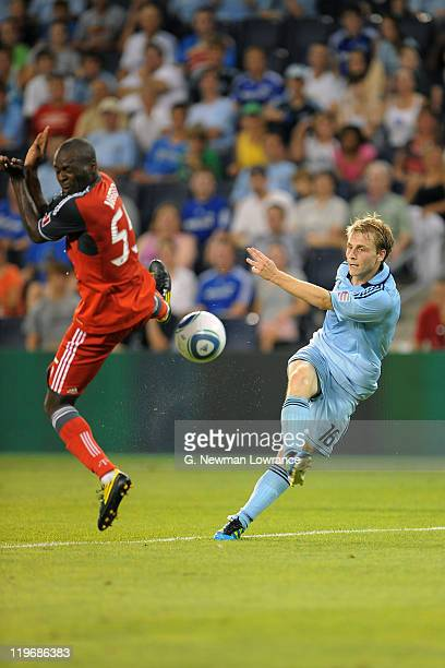 Seth Sinovic of Sporting Kansas City attempts a shot as Eddy Viator of Toronto FC defends on July 23 2011 at LiveStrong Sporting Park in Kansas City...
