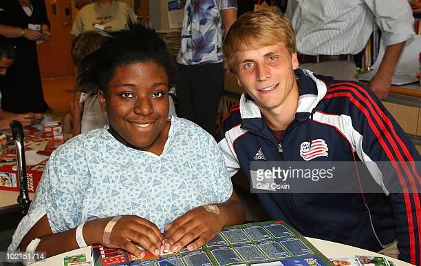 Seth Sinovic of the New England Revolution visits Bianca at the Children's Hospital Boston on June 16 2010 in Boston Massachusetts