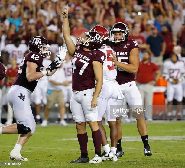 Seth Small of the Texas A&M Aggies celebrates kicking a 28 yard field goal to beat the Alabama Crimson Tide at Kyle Field on October 09, 2021 in...