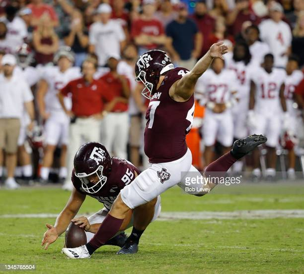 Seth Small of the Texas A&M Aggies kicks a 28 yard field goal out of the hold of Nik Constantinou to beat the Alabama Crimson Tide 41-38 at Kyle...