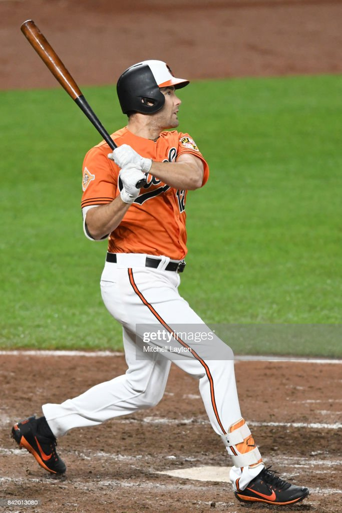Seth Smith #12 of the Baltimore Orioles hits solo home run in the eighth inning during a baseball game against the Toronto Blue Jays at Oriole Park at Camden Yards on September 2, 2017 in Baltimore, Maryland.