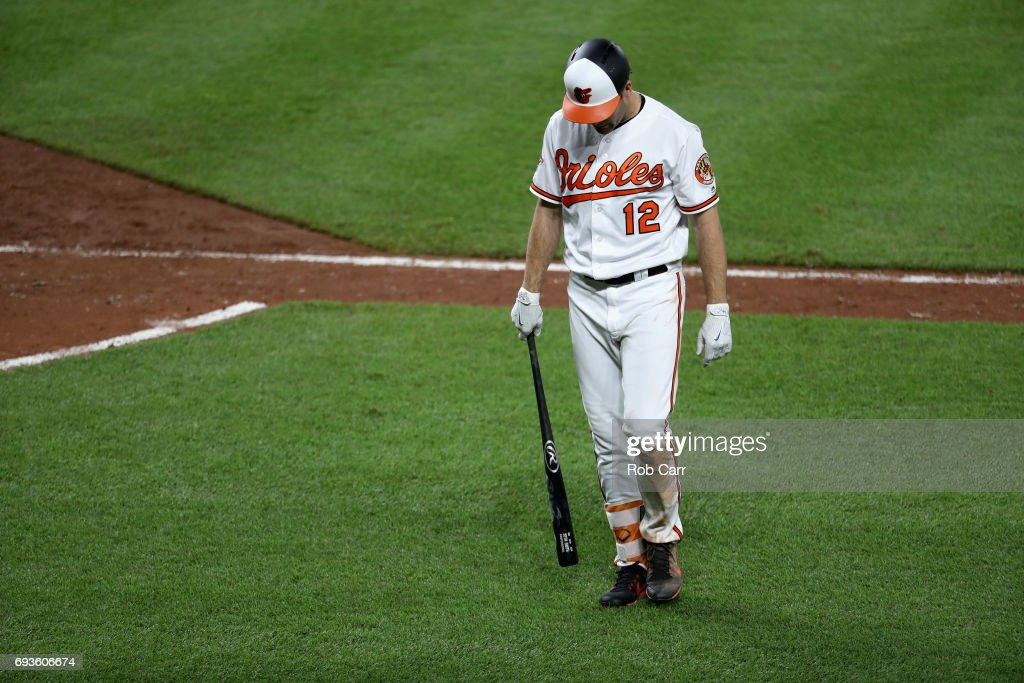 Seth Smith #12 of the Baltimore Orioles walks off the field after striking out against the Pittsburgh Pirates at Oriole Park at Camden Yards on June 7, 2017 in Baltimore, Maryland.