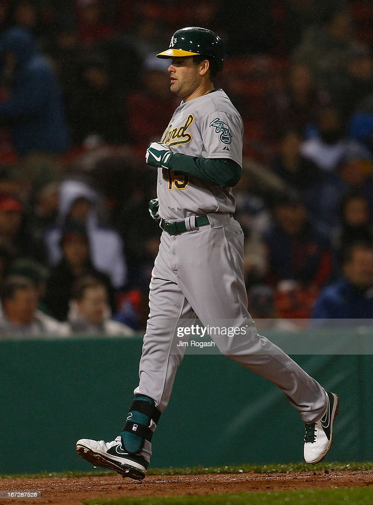 Seth Smith #15 of the Oakland Athletics rounds the bases after hitting a home run against Alfredo Aceves #91 of the Boston Red Sox pauses in the 4th inning at Fenway Park on April 23, 2013 in Boston, Massachusetts.