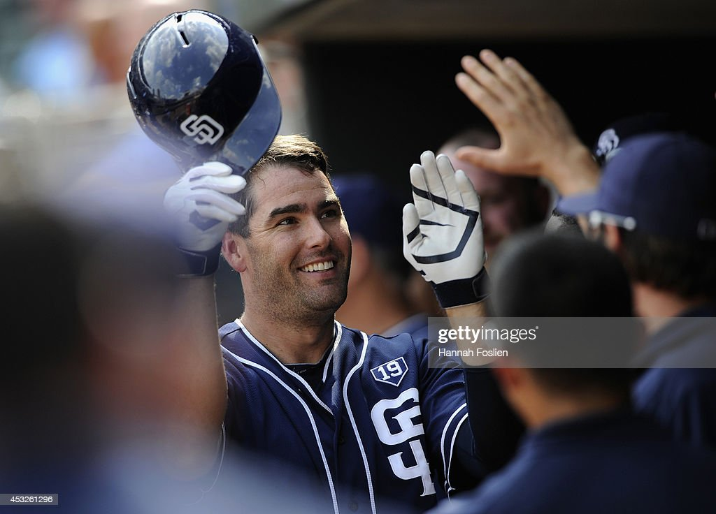 Seth Smith #12 of the San Diego Padres celebrates hitting a solo home run against the Minnesota Twins during the tenth inning of the game on August 6, 2014 at Target Field in Minneapolis, Minnesota. The Padres defeated the Twins 5-4 in ten innings.