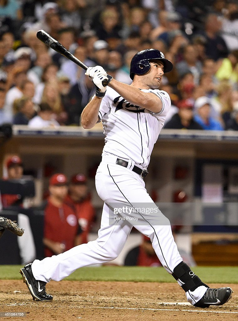 Seth Smith #12 of the San Diego Padres hits a double during the fifth inning of a baseball game against the Cincinnati Reds at Petco Park July 1, 2014 in San Diego, California.