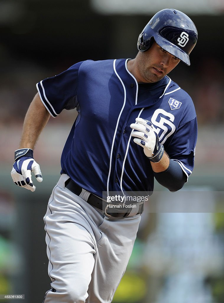 Seth Smith #12 of the San Diego Padres rounds the bases after hitting a solo home run against the Minnesota Twins during the tenth inning of the game on August 6, 2014 at Target Field in Minneapolis, Minnesota. The Padres defeated the Twins 5-4 in ten innings.