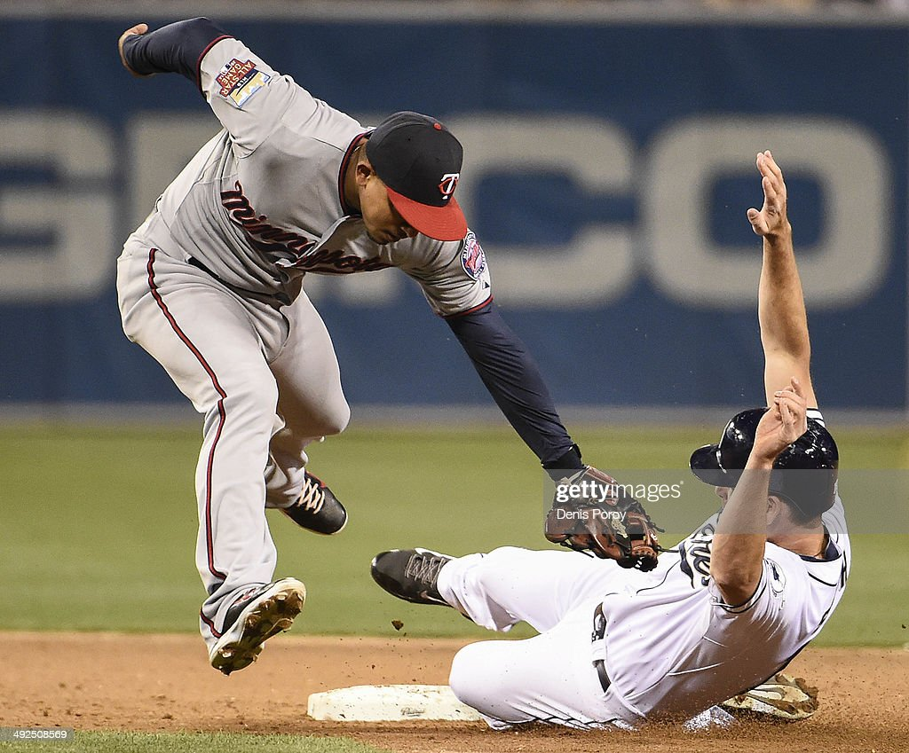 Seth Smith #12 of the San Diego Padres steals second base ahead of the tag of Eduardo Escobar #5 of the Minnesota Twins during the sixth inning of a baseball game at Petco Park May 20, 2014 in San Diego, California.